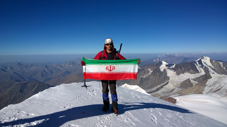 Iran flag on the top of the kazbek peak, Kazbek or Kasbek