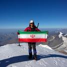 Iran flag on the top of the kazbek peak