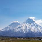 Kliuchevskoy, the highest stratovolcano of Eurasia, partly hidden behind Kamen, Kliuchevskoi