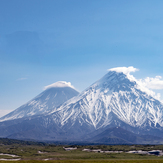 Kliuchevskoy, the highest stratovolcano of Eurasia, partly hidden behind Kamen, Kliuchevskoi