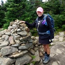 Aug. 23/ 2018. Brisk wind. Trail to summit flowing with rain water.