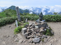 Statue of Japanese god at the peak of Echigo Komagatake, Mount Echigo-Komagatake photo