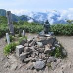 Statue of Japanese god at the peak of Echigo Komagatake, Mount Echigo-Komagatake