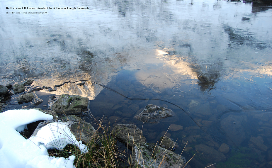 Reflections Of Carrauntoohil On A Frozen Lough Gouragh