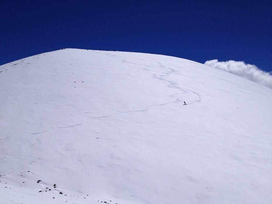 Snow surfing a cone near the summit, Mauna Kea