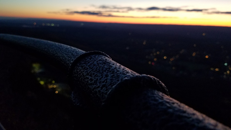 Railing atop Mt Tom, sunset in the distance, Mount Tom (Massachusetts)